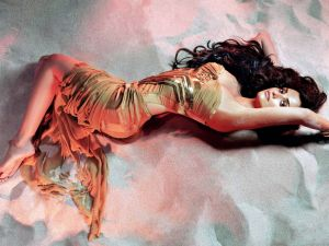 Penelope Cruz lying in the sand