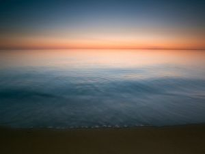 The sea water cutting the horizon