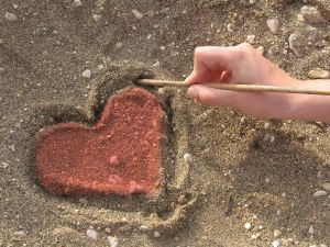 Drawing a heart in the sand