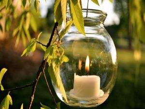 Candle inside a glass jar