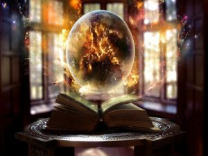 Crystal ball over a book