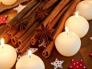 Candles, cinnamon sticks and star anise