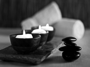 Stones and candles in black and white