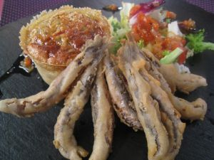 Anchovies with eggplant flan and prawns