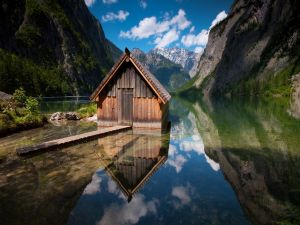 Wooden house reflected in the lake