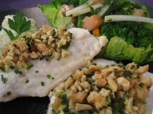 Fish with dried fruit and salad