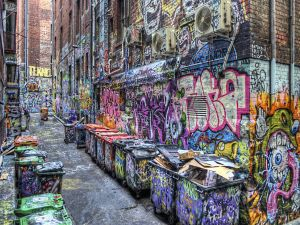 Alley of a city full of graffiti