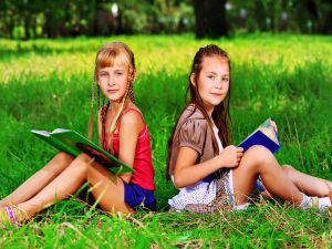 Girls reading her books in the park