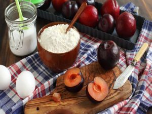 Plums, eggs and flour, to prepare a dessert
