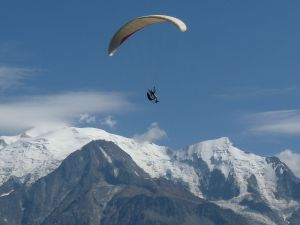 Paragliding in front of the summit of Mont Blanc