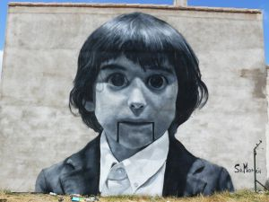 Boy painted on a wall