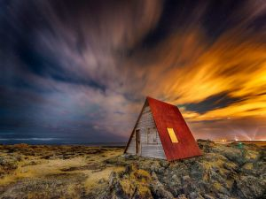 Wooden house next to Iceland sea