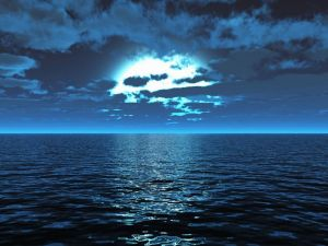 The moon among clouds over the sea