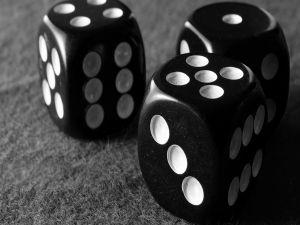 Three black dice
