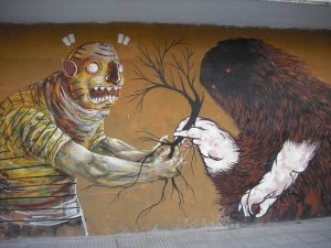 Two beings drawn on a wall