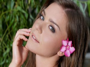 Model with a pink flower in her ear