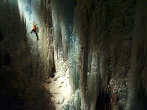 Climbing the icy walls of a cave