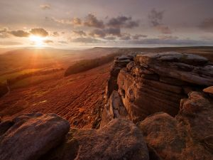 The sun rises and caresses the rocks