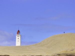 Man approaching to a lighthouse
