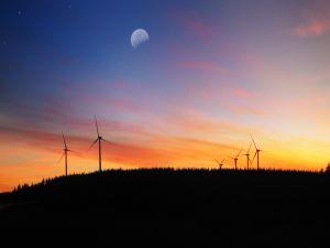The moon over a wind farm