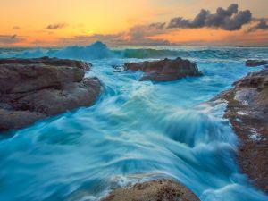 The sea caressing the rocks