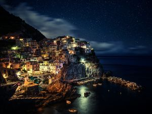 Village next to the sea and under a blanket of stars