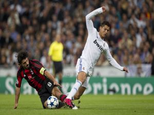 Cristiano Ronaldo (CR7) about to fall to the floor
