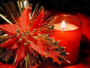 Candle and Christmas ornament in red