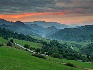 Road between green mountains
