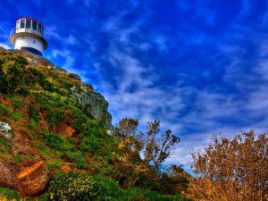 The lighthouse under a blue sky