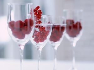 Crystal glasses with red fruits