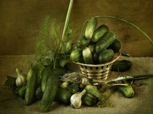 Still life with garlic and cucumbers