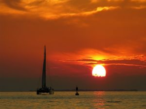 Sailing under a reddish sky