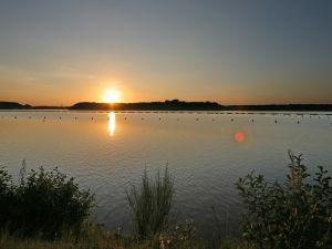 The sun illuminating the surface of the lake