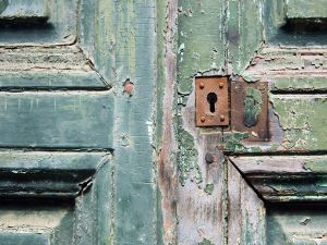Wooden door with an old lock