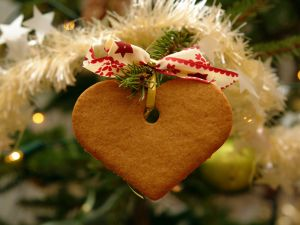 Heart shaped cookie in the Christmas tree