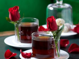 Original tea cups with a red rose