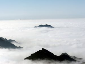 The mountains poking through the sea of clouds