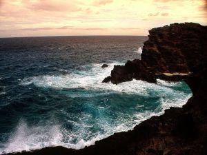 The sea crashing against the rocks