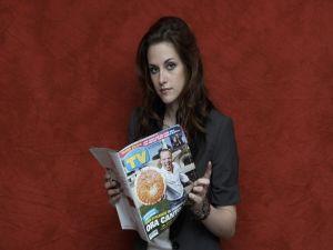 Kristen Stewart with a magazine