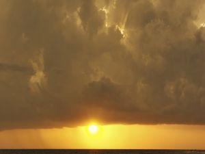 The sun peeking under the clouds