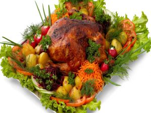 Roast chicken with potatoes and other vegetables