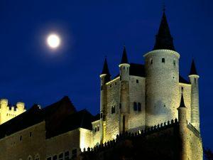 The full moon over Alcázar of Segovia