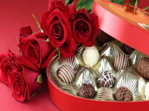 Bouquet of roses and a gift box with chocolates