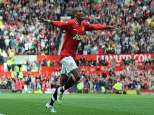 Ashley Young celebrating a goal with Manchester shirt