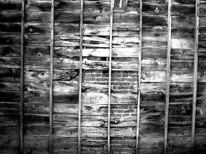 Planks covering a brick wall