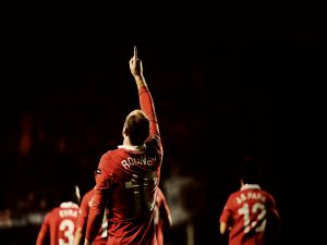Wayne Rooney pointing to the sky