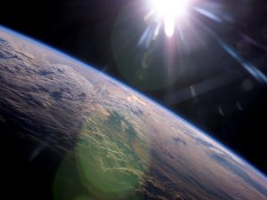 The Sun illuminating and heating the Earth
