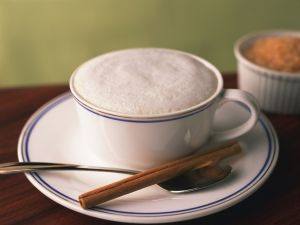 Coffee with cream and cinnamon