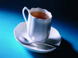 White cup with tea